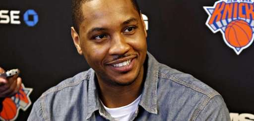Knicks forward Carmelo Anthony talks to reporters at