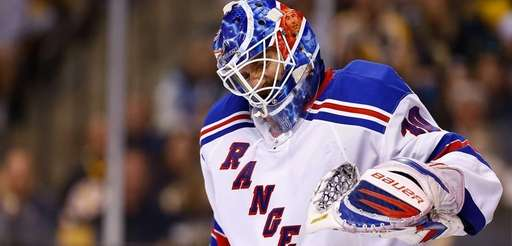 Henrik Lundqvist grimaces in pain from his left