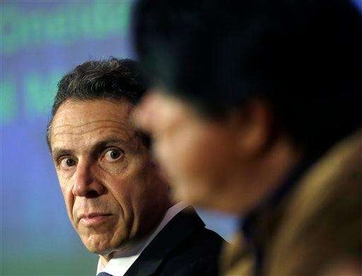 In this file photo, Gov. Andrew Cuomo listens