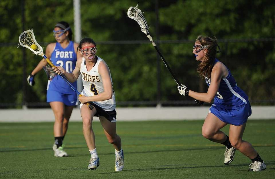 Massapequa midfielder Kristin Yevoli is defended by Port