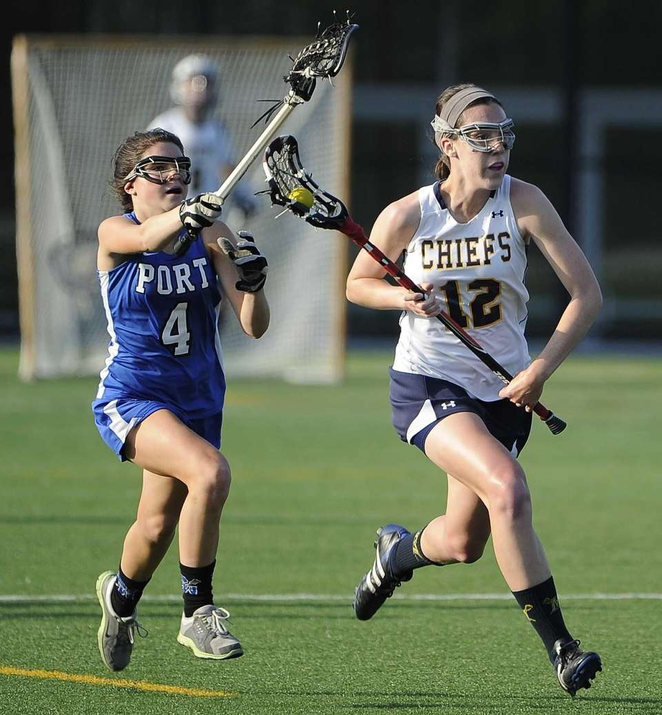 Massapequa midfielder Danielle Doherty is defended by Port