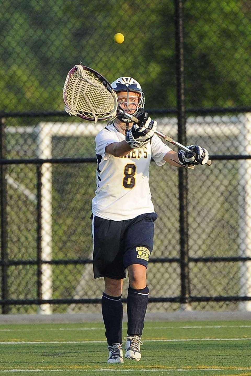 Massapequa goalie Samantha DePasquale clears the ball against