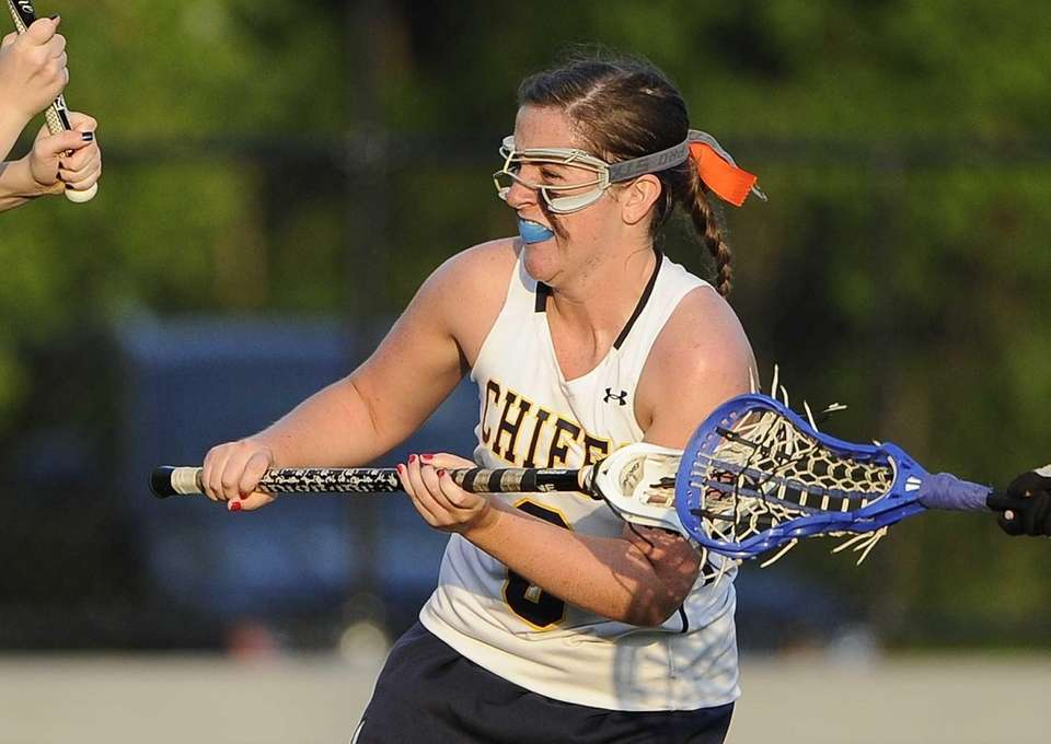 Massapequa attacker Hayley Burke shoots and scores against