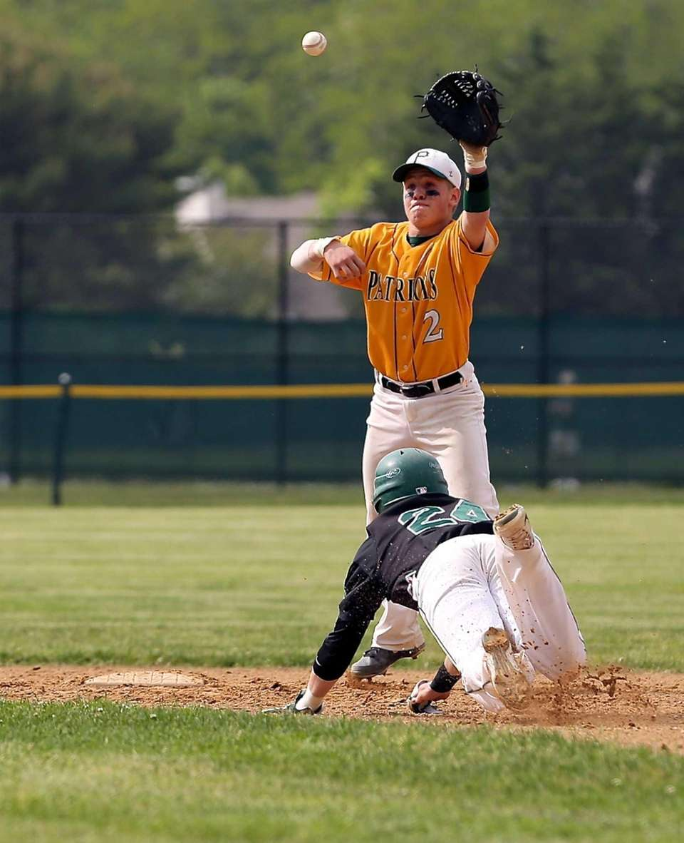 Ward Melville's Zach Hood waits for the throw