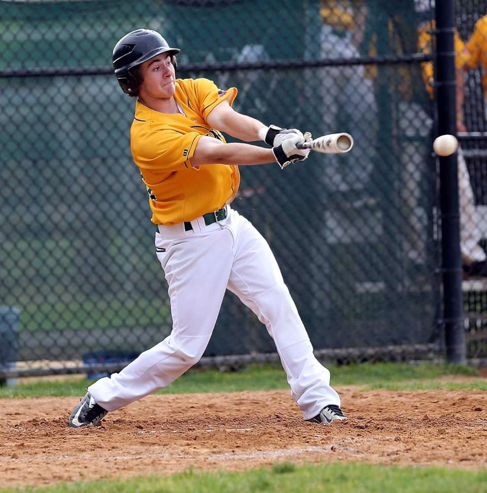 Ward Melville's Ryan Shields takes a swing during