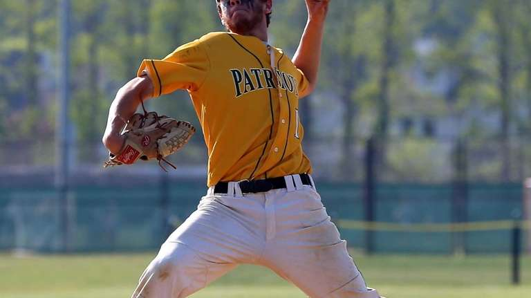 Ward Melville's Anthony Kay delivers a pitch in