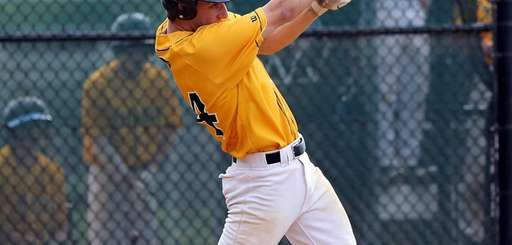 Ward Melville's Joe Flynn watches his home run