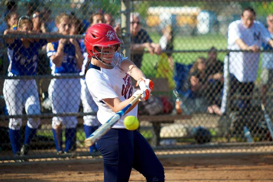 MacArthur shortstop Jena Cozza (9) takes a swing