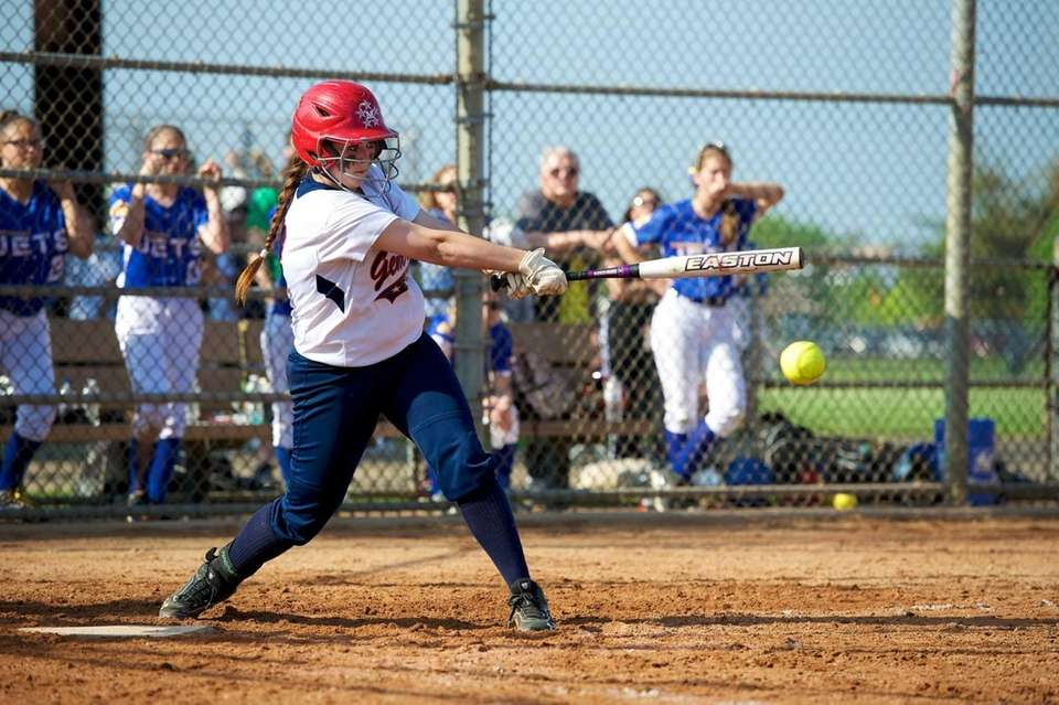 MacArthur first baseman Katie Fitzsimmons (13) makes contact