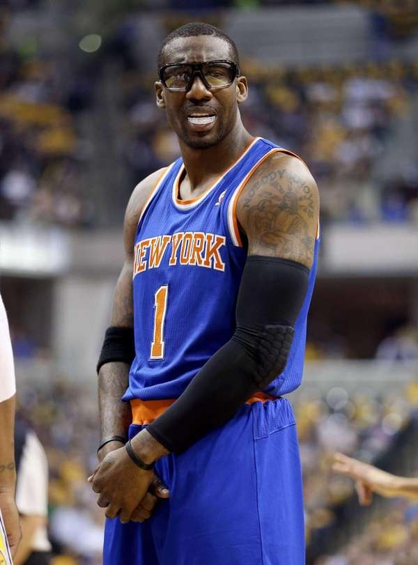 Amar'e Stoudemire looks at an offical after being