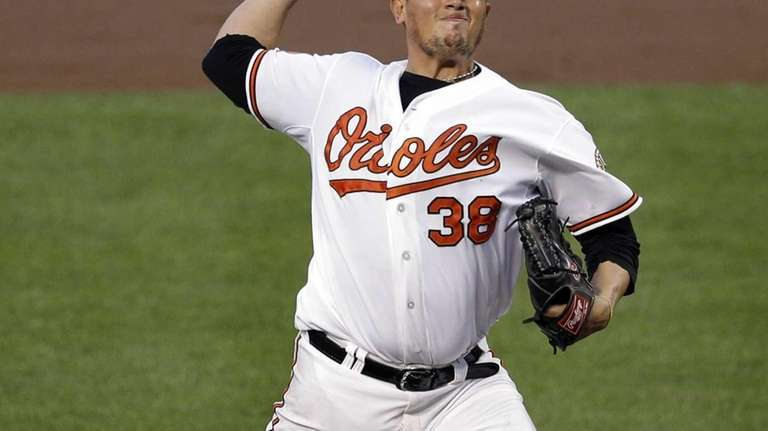 Baltimore Orioles starting pitcher Freddy Garcia delivers a