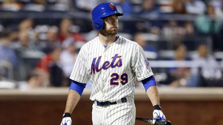 Ike Davis walks back to the dugout after