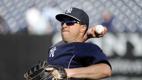 Mark Teixeira plays catch before a game against