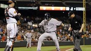 Travis Hafner crosses home plate after hitting a
