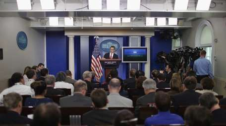 White House Press Secretary Jay Carney takes questions