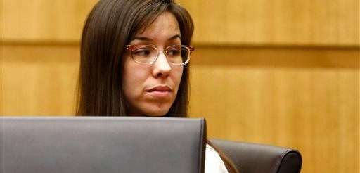 Jodi Arias looks at her family during the