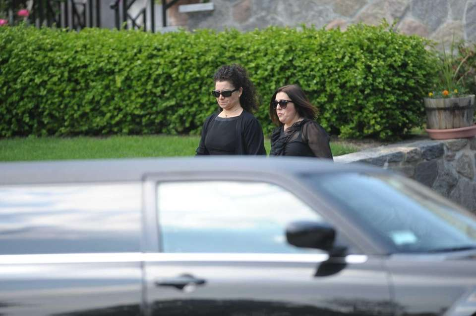 Family members of Andrea Rebello leave their home