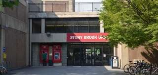 "A <a href=""/topics//Stony_Brook_University"">Stony Brook University</a> student from <a href=""/topics//Elmhurst,_NY"">Elmhurst</a>, Queens, pleaded not guilty to felony drug charges after authorities seized $35,000 in cash, marijuana, hallucinogens and drug paraphernalia from her dorm room, officials said."