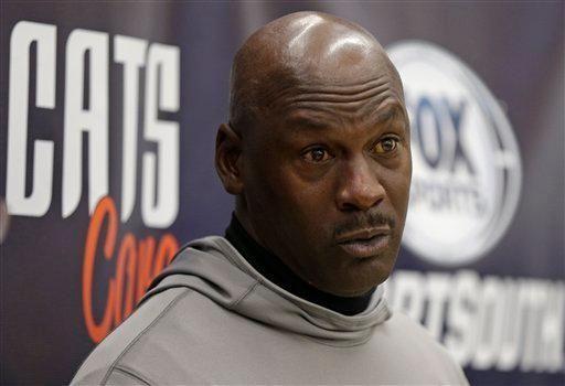 Charlotte Bobcats owner Michael Jordan speaks to the