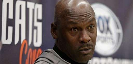Charlotte Bobcats owner Michael Jordan speaks to the