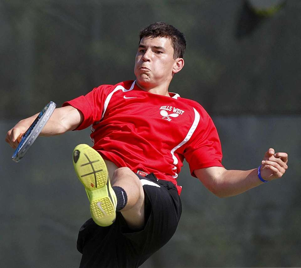 Hills West's first doubles player Lucas Udall hits