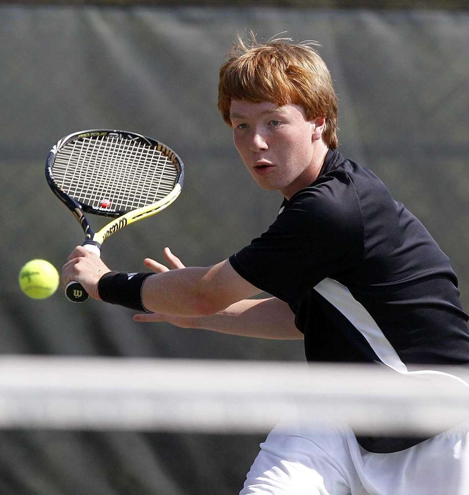 Hills East's first doubles player Travis Leaf hits