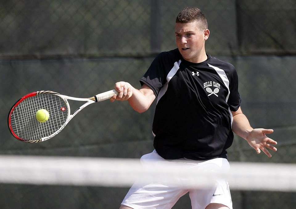 Hills East's first doubles player Ross Reiffman hits