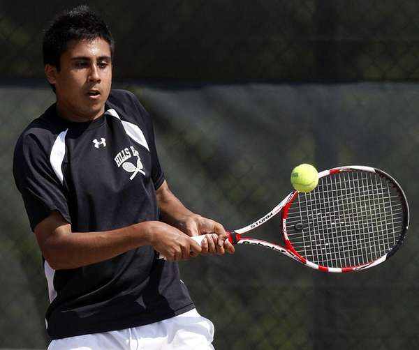 Hills East's first singles player Zain Ali hits