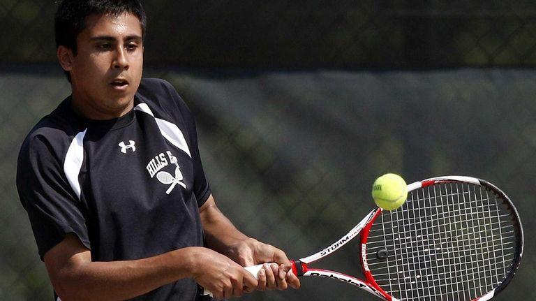Hills East's first singles player Zain Ali hits