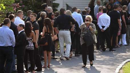 Family and friends attend the wake for Andrea