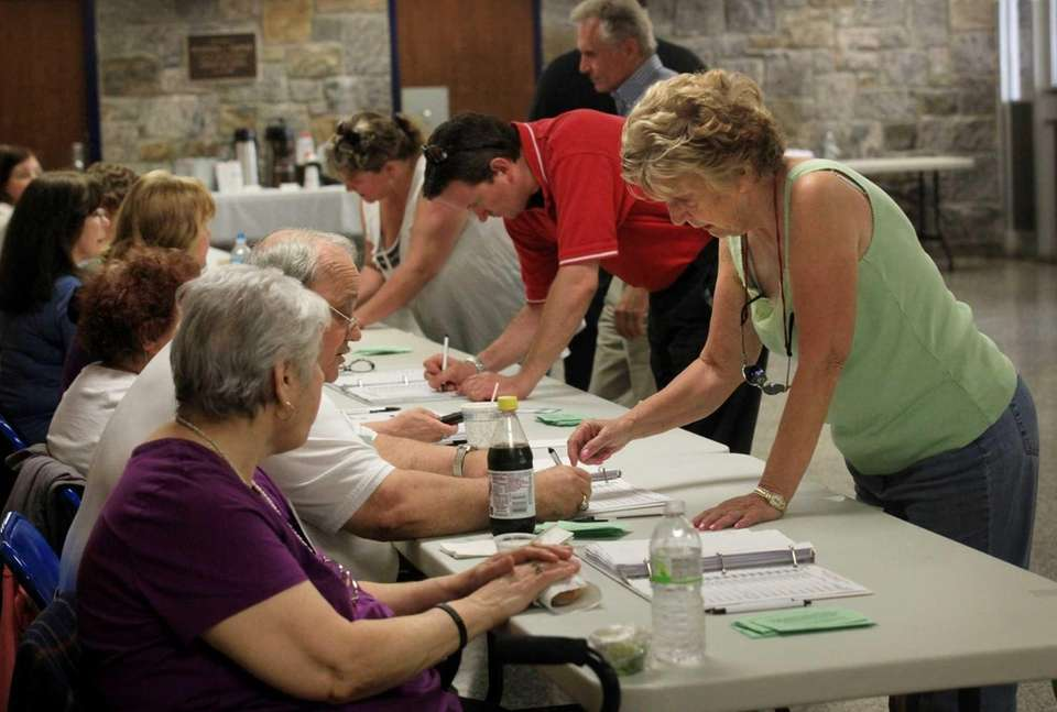 Voters check in at Centereach High School before