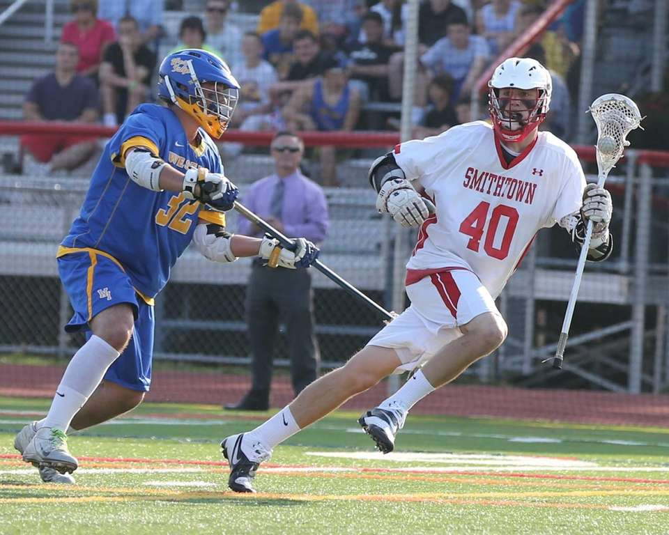 Smithtown East's Brian Willetts #40 maneuvers around the