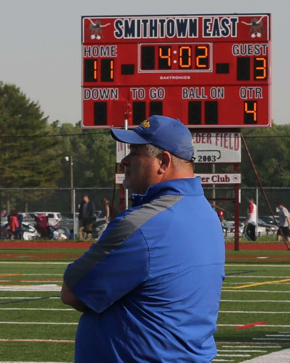 West Islip head coach Scott Craig looks on
