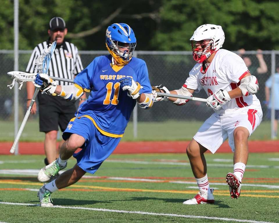 Smithtown East defenseman Peter Triolo #8 tries to