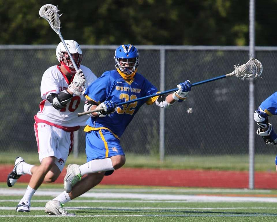 West Islip's Joe Barcia #32 moves the ball