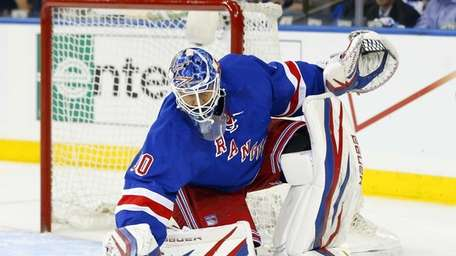 Henrik Lundqvist makes a save during Game 3