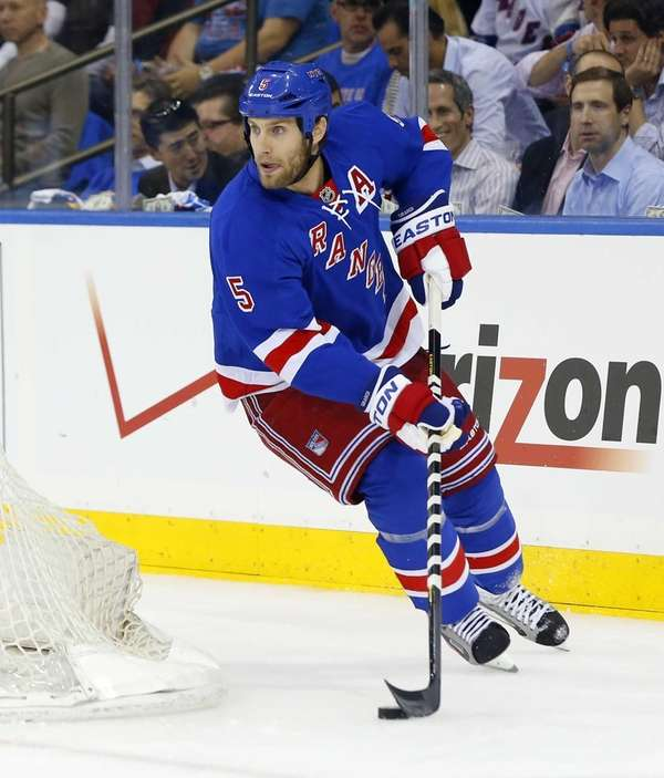 Dan Girardi skates in the first period during