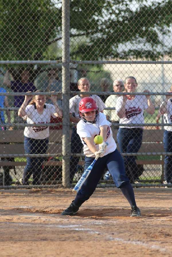 MacArthur's Katie Fitzsimmons hits a two-run double to