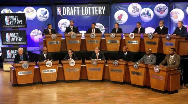 NBA basketball team representatives sit onstage at the