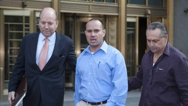 Edwin Vargas, center, exits Federal Court after being
