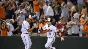 Baltimore Orioles third base coach Bobby Dickerson, left,