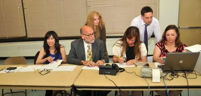 Superintendent Carole Hankin, left, joined Syosset School Board
