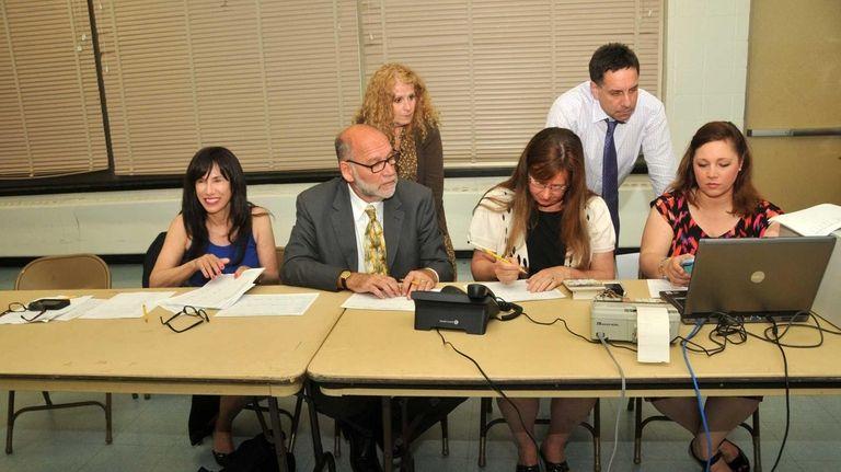 Superintendent Carole Hankin, left, joined Syosset School Board