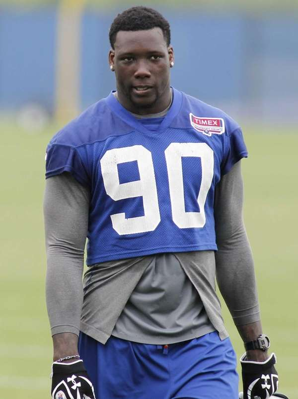 Jason Pierre-Paul looks on during OTAs at Timex