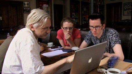 Julian Assange, left, with WikiLeaks staffers