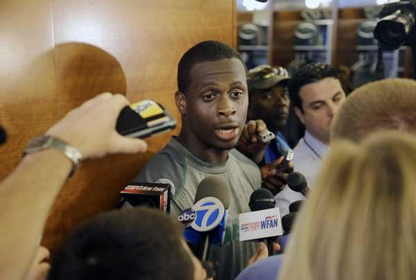 Geno Smith answers questions from the media in