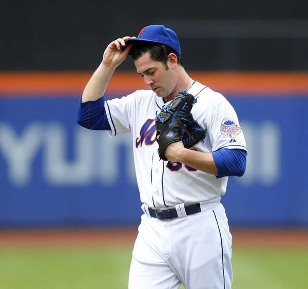 Matt Harvey looks on after surrendering a three-run