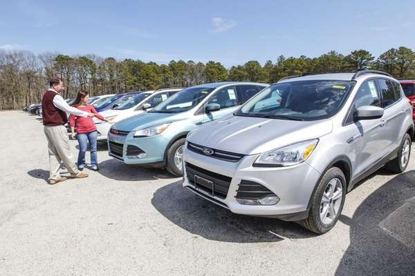 Salesman Thomas Hart shows a Ford Escape to