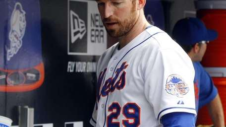 Ike Davis of the Mets stands in the