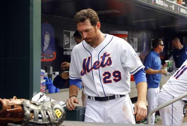Ike Davis stands in the dugout after the